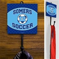This exclusive Soccer Sport Hook is made from hand-forged steel and features a customized printed tile. Hang your coat, hats, pinnies, and medals in style. Soccer Room Decor, Forged Steel, Tile, Display, Sport, Printed, Hats, Floor Space, Mosaics