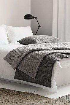 www.naturalbedcompany.co.uk for soft white cotton bedding and grey throws and quilts....