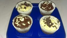 Chocolate cupcakes with chocolate or vanilla frosting and white or dark choclate curls