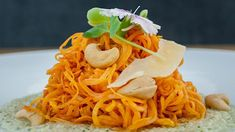 Sweet Potato Noodles in Cheesy Cashew Sauce Ingredients 2 sweet potatoes 1 ¼ cup ml) cashews 1 ¼ cup ml) water 2 tbsp ml) Parmesan 4 cloves garlic, roasted olive oil, for frying 1 tbsp ml) fresh basil, torn, for topping Directions Soak ca Sweet Potato Spiralizer Recipes, Veggie Recipes, Vegetarian Recipes, Healthy Recipes, Veggie Meals, Vegetarian Dinners, Vegetarian Options, Veggie Dishes, Healthy Meals
