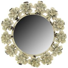 This round metal mirror surrounded by distressed 3-D metal roses adds a vintage touch to any room's decor.