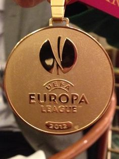 europa league medals - Google Search - Circular medal, bronze, logo symbolic of europa league cup Bill Shankly, Trophies And Medals, Europa League, Premier League, Flask, Design Inspiration, Bronze, Football, Logo