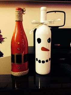 Santa and Snowman wine Bottles we made this weekend