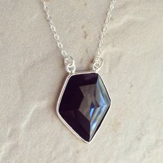 Black onyx shield pendant with sterling silver bezeled edge on sterling silver chain - Choose your length by BlueRavenHandcrafted on Etsy https://www.etsy.com/listing/211880397/black-onyx-shield-pendant-with-sterling