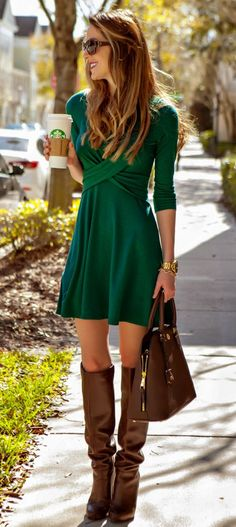 Hunter green dress with brown riding boots, brown Tory Burch Robinson satchel, and gold accessories | Style Guide: What to Wear to a Fashion Show + 10 trendy outfit ideas that anyone can wear by fashion blogger Stephanie Ziajka from Diary of a Debutante