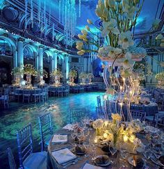 Under the Sea, diy, wedding, event, uplighting, uplights, blue uplighting, teal, gobo, monogram, pattern gobo, centerpieces, formal, dance, flowers, tall centerpieces