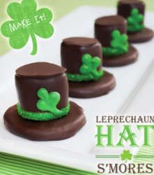 DIY Tutorial: Leprechaun Hat S'mores: A Fudge Stripe Cookie base is topped with a marshmallow and then coated in chocolate to create one delicious little smore hat!