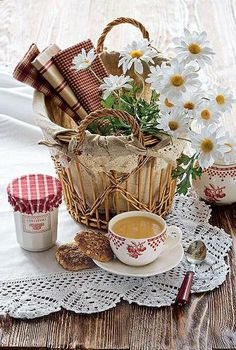 .basket with fabric and daisies and a cup of tea