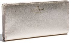Kate Spade wallet; gold, silver or patent. Available for cheaper at the Allen outlets, good selection!