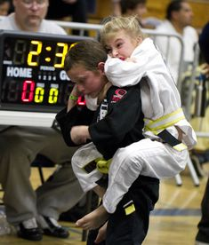Jiu-Jitsu lessons- $40  Competition fees- $150  The look on both their faces- $priceless