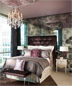 smoky mirrored wall, plum palette...elegant, sophisticated, yet very cozy looking...love it, especially the headboard and little nightstand.
