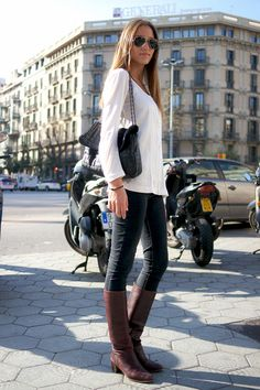 Barcelona, Spain Who: Trilce What: A pair of worn-in vintage boots will last a lifetime of effortless casual looks. Wear: Zara top, H&M pants, vintage boots, Ray-Ban sunglasses - Elle