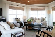 Neutral living room with dark wood accents