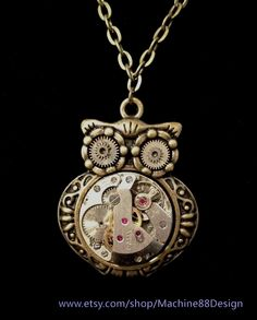 Steampunk owl pendant with vintage ruby watch movement and gears