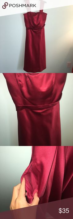 Red Satin Dress Worn once. It has been altered. I am a size 00 because I have lost a lot of weight so I'd estimate it's fit best on a size 4-5. Pockets on both sides and has a belt around it. The zipper is on the back. David's Bridal Dresses Midi
