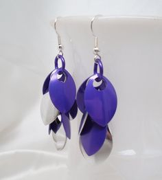 New dragon scale earrings in purple and silver.  These are on my Etsy shop - DesignsByAlladania.