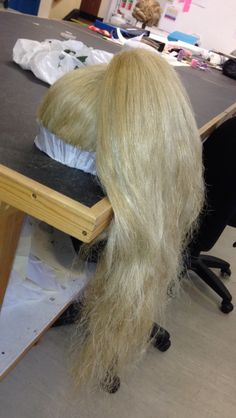 Wigs and millinery