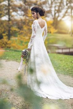 A-Line lace wedding dress from Ingrida Bridal wedding dress shop