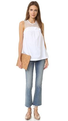 A webbed-lace yoke lends a delicate element to this gathered poplin Marissa Webb top. Button back keyhole. Sleeveless. Semi-sheer.