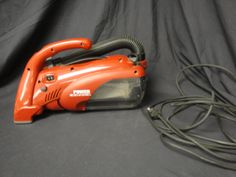 Really Nice Dirt Devil with Power Reach Nozzle. Bagless. Tested and works great! Nice long cord.