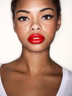 a classic makeup look: red lips + black winged liner ... + freckles. such a beauty.