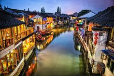 Twilight over a canal in Zhujiajiao, an ancient town in the Qingpu district of…