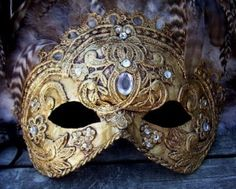 Gold Venetian mask with variegated feathers,...