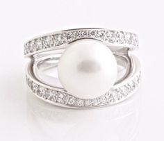 CHOPARD 18K White Gold, White Diamond and Pearl Ring Size 7 Chopard,http://www.amazon.com/dp/B008SC4NQ4/ref=cm_sw_r_pi_dp_itghtb0JQCCSQ8GH