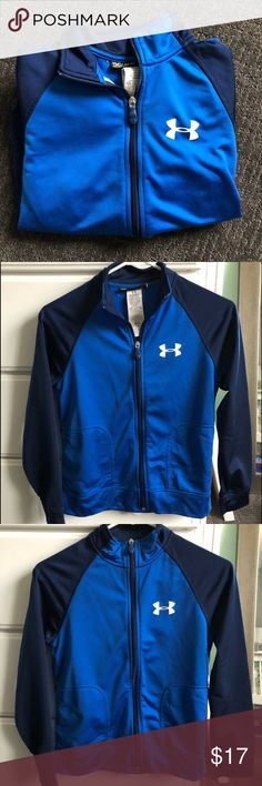 Under Armour Boys Full Zip Sweatshirt This sweatshirt has barely been worn and has no signs of wear or damage! It is loose fitting and is colored navy, bright blue, and white. Feel free to comment with any questions or make an offer! I'm willing to negotiate. Check out the other Under Armour items on my page as well, it's cheaper to bundle! Under Armour Shirts & Tops Sweatshirts & Hoodies