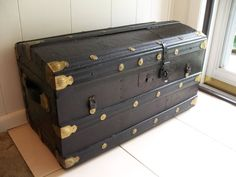 Vintage travel trunk - steamer suitcase for the corner of the room, or as a coffee table if flat enough.