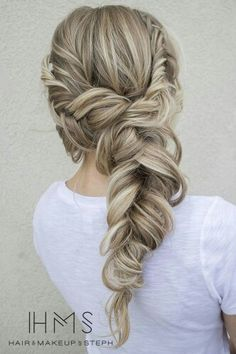 Dirty blonde hair with a messy fishtail braid