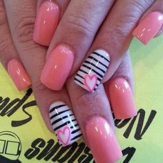 Coral pink nails with black & white stripe accent nail with coral heart on the stripes