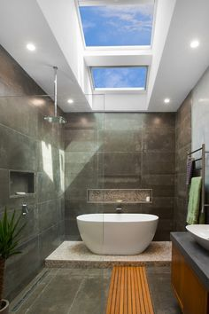 Get ideas and inspiration from our room gallery to see how you can add natural lighting to your home and create a masterpiece with VELUX Skylights. Wet Room Bathroom, Bathroom Renos, Modern Bathroom, Modern Skylights, Flat Roof Skylights, Bad Inspiration, Bathroom Inspiration, Skylight Bedroom, Skylight In Bathroom