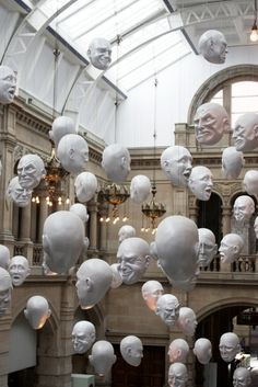 Hanging Heads, Kelvingrove Art Gallery and Museum, Glasgow, Scotland--styrofoam wig heads painted white and hung would be a great