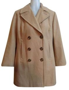Banana Republic Tan Pea Coat, Size M, $42. A classic wardrobe staple. Double breasted camel peacoat from Banana Republic in great condition. *horizontal darts *faux horn buttons *very deep vertical pockets *fully lined in gold *interior pocket. Please feel free to message me with any questions!