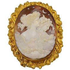 Antique Victorian Cameo Brooch Eos and Nyx Goddesses of Day and Night. Victorian hand carved Day and Night shell cameo features Eos Goddess of the Day and Nyx Goddess of the night, accompanied by the royal eagle, Zeus the God of Gods. This is a large Victorian Cameo in Pinchbeck Mount. Measures 3.125 inches by 2.5 inches. The Cameo detail is very fine and most likely Italian in origin. Circa 1860.