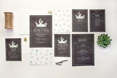 A wedding stationery suite with all different kinds of succulents on a dusty chalkboard.