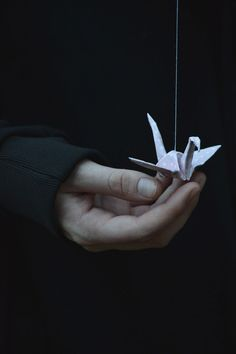 """Here,"" I whispered, ""Take it.""  Halloween hesitated, then took up the paper crane. Her hands, they were spidery and brutish, but she handled the bit of folded paper like glass.