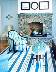 """Surfboard Coffee Table-Purchased from a vendor who makes tables out of vintage surfboards and skis, the coffee table in the family room of this Cape Cod beach house gives the room a relaxed, lived-in feel. """"Every room should have something that makes you smile,"""" says designer Annie Selke."""