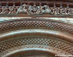 *SPAIN~Church Moarves de Ojeda: door archivolts and sculptural frieze. Its parish church, dedicated to San Juan Bautista, accommodates the extreme north of the small village, to the very edge of the road that leads to Cervera de Pisuerga and quite sandwiched between houses.