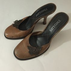 Two lips These two lips shoes they are brown and black with a little wear Two lips Shoes Heels