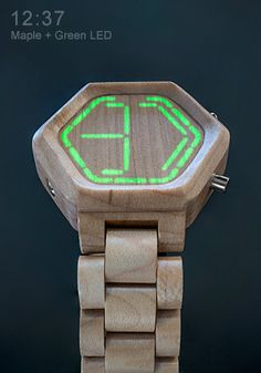 The maple wood and green LED Kisai Night Vision Wood watch. The minimal appearance of this watch will have people wondering why your watch has no hands. Press the button and all will be revealed. LEDs concealed beneath the wood surface will shine through to display the time.