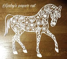 Floral horse paper cutting template. size A4. For personal use only . Please recommend the designer when needed.