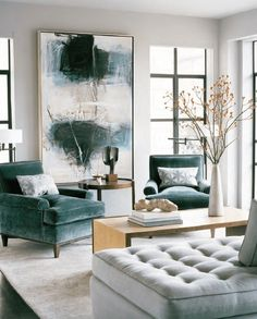 Abstract expressionist painting in living room with beautiful teal velvet chairs. Art is one of our top interior design trends for 2017; use large artwork to add interest and personality to your home.