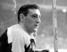 A youtthful Phil Esposito on the Bruins bench.