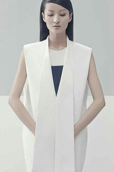 Straight thick symmetrical long masculine vertical lines add height and look strong, minimalistic, sophisticated and confident. Structured Minimalism Attire - The Liao Dan Spring/Summer 2014 Collection Embraces Simplicity (GALLERY)