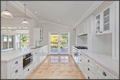 Queenslander kitchen white light pendant lights french doors verandah