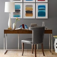 Kerouac Desk...loving the artwork as a blast of color against the greys and wood tones.