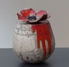 I like the dripped glaze over the naked raku
