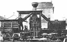 An early Shay Locomotive - photo taken in 1880. Ephraim Shay (1839-1916) was a logger himself, and like those who try to build a better mousetrap, he decided to build a better logging locomotive. In 1880, he constructed a successful prototype, basically a flatcar with a steam boiler mounted amidships; fuel and water on opposite ends. What set this locomotive apart was the unusual cylinder arrangement. Two vertical cylinders drove a crankshaft, which in turn drove a pair of geared trucks…